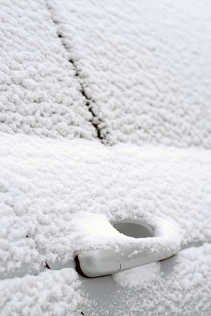 driving conditions: Close-up of snow-covered car doors
