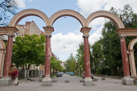 Arch on a green city street photo