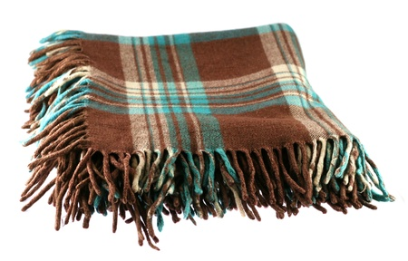 Brown-green checkered tartan wool blanket with fringe isolated on white photo