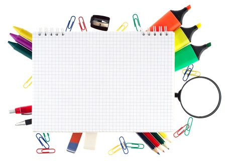 Notepad with stationary objects on white background
