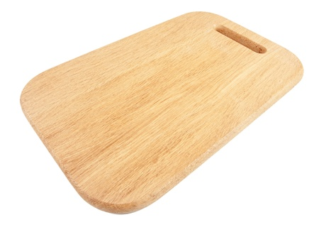 Wooden chopping board isolated on white background photo