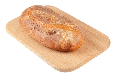 Bread loaf on a wooden chopping board isolated on white photo