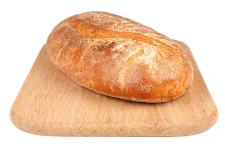 Loaf of a bread on a chopping board isolated on white photo