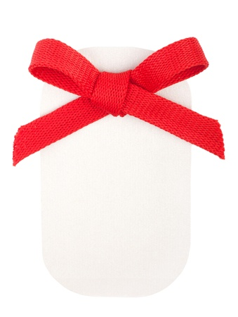 Red bow on a paper badge isolated on white photo