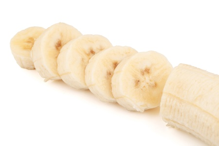 Sliced bananas on a white background photo