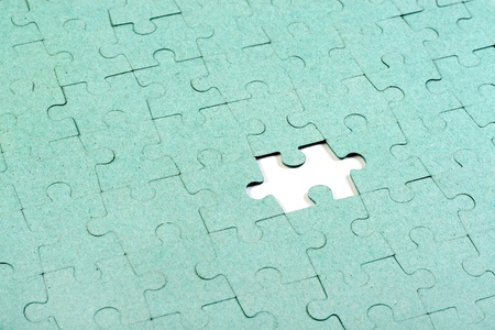 Green puzzle with missing piece Stock Photo - 11405645