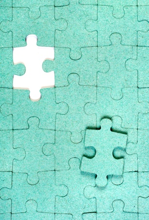 Green puzzle with missing piece photo