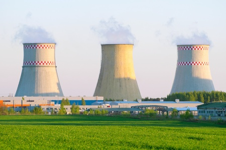 Power plant with huge cooling towers against blue sky Stock Photo - 11400850