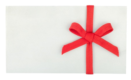 Red bow on a white box or envelope isolated on white photo