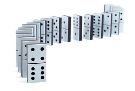 Line of domino pieces on white background photo
