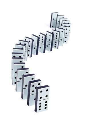 consequence: Domino pieces in a line on white background Stock Photo