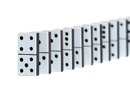Domino pieces in a line on white background photo