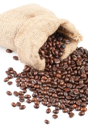 Coffee beans in canvas sack isolated on white photo