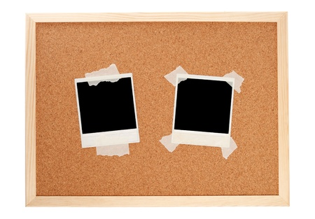 Black instant photos on a cork board photo
