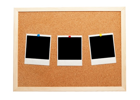 Blank instant photos on a corkboard photo