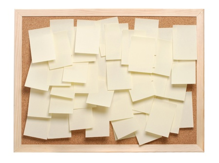 A lot of note papers on a cork board photo