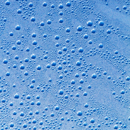 Water drops on a grey-blue background photo