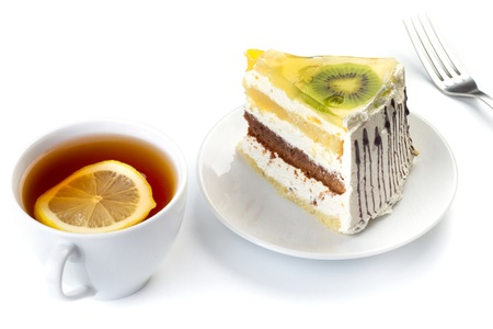 A cup of tea and a piece of tasty creamy cake with fruits Stock Photo - 16068833
