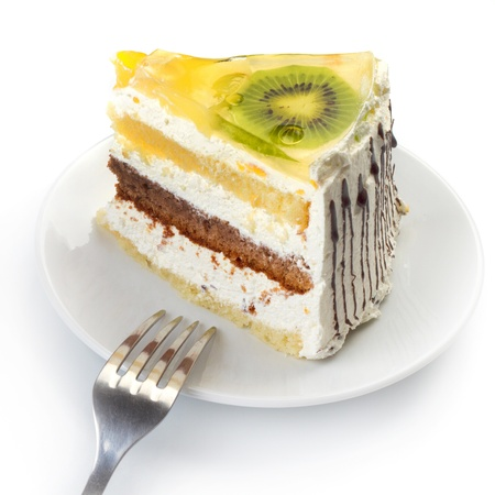 A cup of tea and a piece of tasty creamy cake with fruits Stock Photo - 16068510