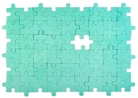 piece of paper: Green puzzle with missing piece Stock Photo