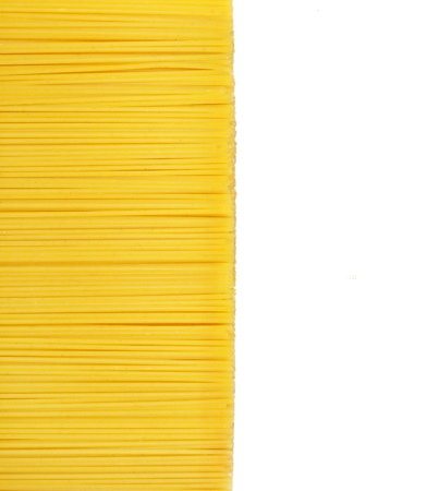 Uncooked pasta on white background photo