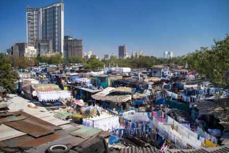 MUMBAI - 12 DECEMBER 2012: People at Dhobi Ghat, the worlds largest outdoor laundry on December 12, 2012 in Mumbai, India.