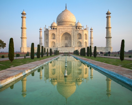 mahal: A perspective view on Taj Mahal mausoleum with reflection in water. Agra, India. Stock Photo