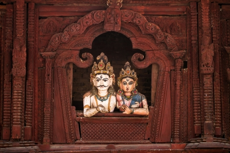 parvati: Shiva and Parvati wooden figures in the window of Shiva Parvati Hindu temple at Durbar Square in Kathmandu, Nepal Stock Photo