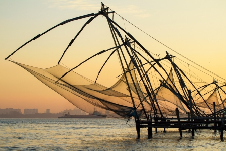 Chinese fishing net at sunrise in Cochin (Fort Kochi), Kerala, India photo