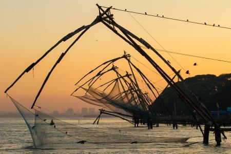 chinese fishing nets: Chinese fishing net at sunrise in Cochin  Fort Kochi , Kerala, India