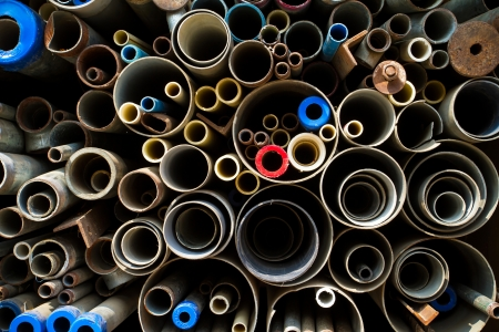 Stacked steel pipes and tubes background photo