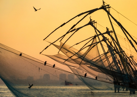 Chinese fishing net at sunrise in Cochin  Fort Kochi , Kerala, India photo