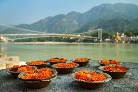 puja: Puja flowers offering for the Ganges river in Rishikesh, India
