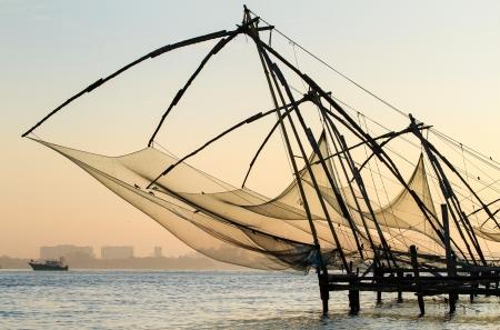 Chinese fishing net at sunrise in Cochin (Fort Kochi), Kerala, India photo
