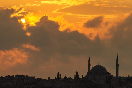 Silhouette of a mosque at the sunset photo