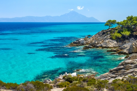 greece shoreline: Rocky coastline and a beautiful clear water at Halkidiki Kassandra peninsula in Greece Stock Photo