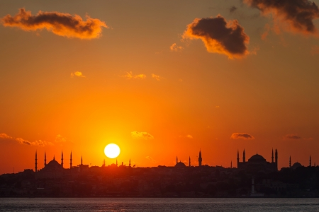 Istanbul silhouette. Blue Mosque and Hagia Sophia at sunset. photo