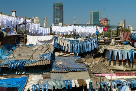 MUMBAI - 12 DECEMBER 2012: People at Dhobi Ghat, the world's largest outdoor laundry on December 12, 2012 in Mumbai, India.