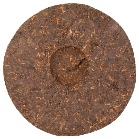 Pressed Chinese puer tea isolated on a white background. photo