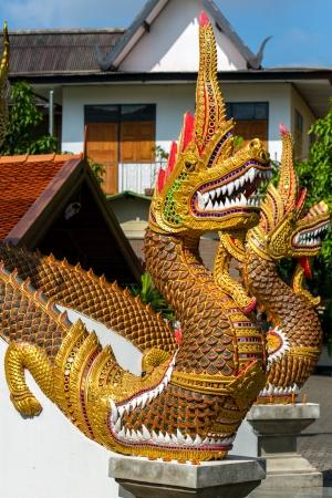 naga china: Dragon guard statue at the buddhist temple entrance in Thailand Stock Photo