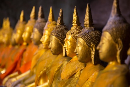 Golden Buddha statues photo