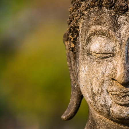 Stone Buddha head statue close-up photo