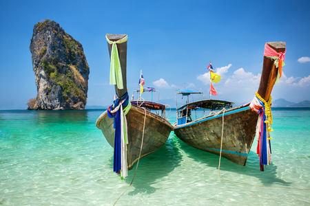 longtail: Longtail boat at the tropical beach of Poda island in Andaman sea, Thailand