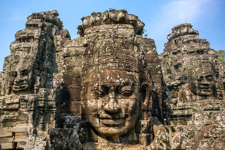 Stone faces on the towers of ancient Bayon Temple in Angkor Thom, Cambodia photo