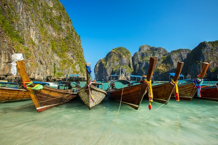 Longtail boats in Maya Bay, Koh Phi Phi Leh, Krabi, Thailand photo