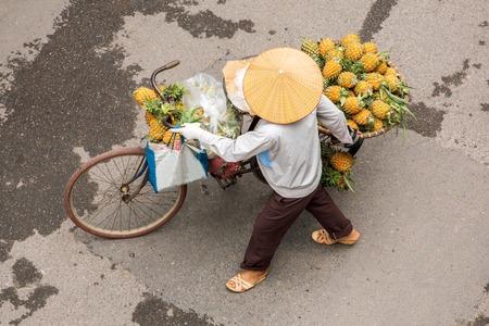 Street vendor on a bicycle in Hanoi, Vietnam