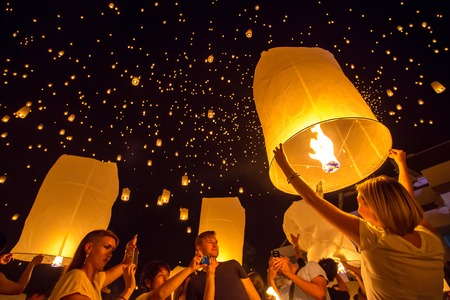 CHIANGMAI, THAILAND - NOV 16: People release sky lanterns to worship Buddhas relics during Yi Peng festival on November 16, 2013 in Chiangmai, Thailand