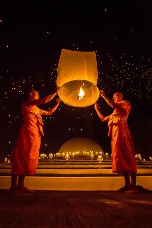 CHIANGMAI, THAILAND - NOV 16: Buddhist monks release sky lantern to worship Buddhas relics during Yi Peng festival on November 16, 2013 in Chiangmai, Thailand