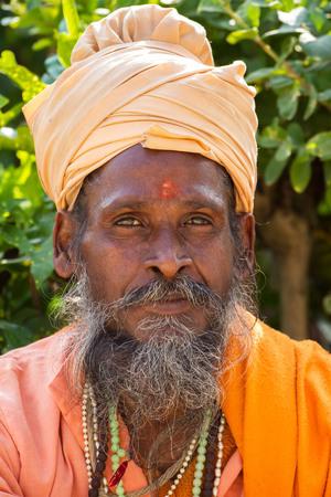 alleged: RISHIKESH, INDIA - NOVEMBER 16: An unidentified portrait sadhu November 16, 2012 in Rishikesh, India. Tourism has drawn many alleged fake sadhus to Rishikesh Editorial