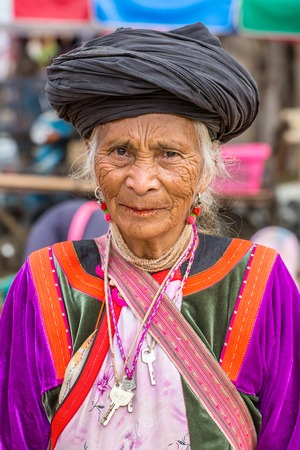 PAI, THAILAND - DECEMBER 11, 2014: Unidentified  Lisu tribe woman in traditional costume in Pai village, Thailand.